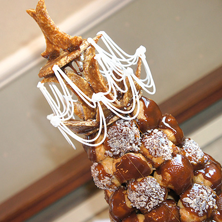 Croquembouche top decorated with nougatine and piped royal icing