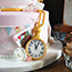 decorated with edible pocket watch, playing cards, bunting and flowers