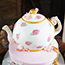Carved cake teapot with handpainted roses